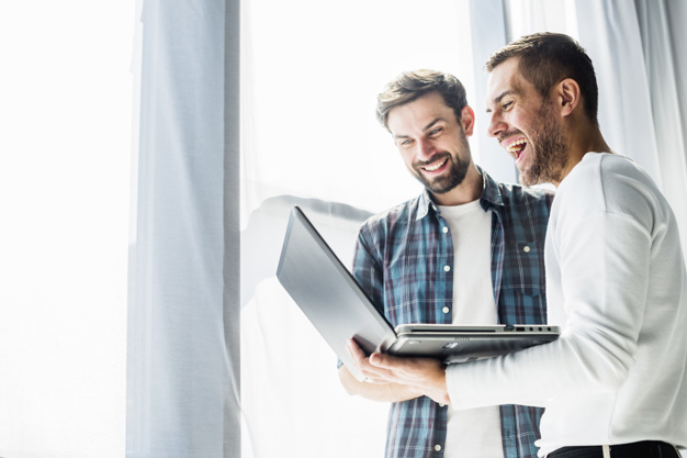 two happy businessman working on laptop 23 2147839880 - Knowledge Counts: What Can You Learn From Technology Conferences?