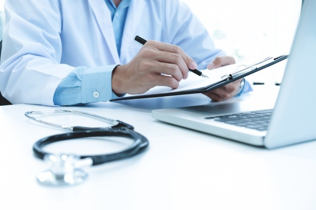 doctor working with laptop computer and writing on paperwork hospital background 1421 69 - A Look at Application: How Does Technology Affect Daily Life?