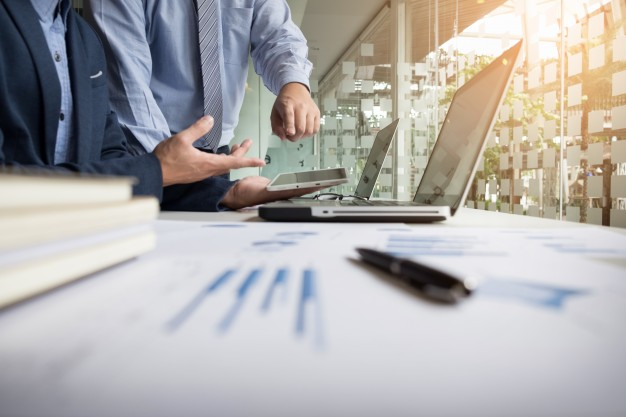 business adviser analyzing financial figures denoting the progress in the work of the company 1423 97 - The Tools You Can Use to Better Improve Your World