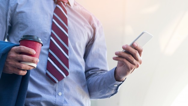 young and successful businessman is reading a message on his smartphone 1423 176 - Contact Mesh Forum